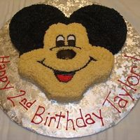 "Mickey Mouse Birthday Cake Buttercream icing. 9"" round and two 6"" rounds. Found the idea on here since Wilton doesn't make the Mickey pan right now."