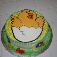 Easter Cake A 8 inch cake covered with Pastry Pride and topped with a Color Flow chick