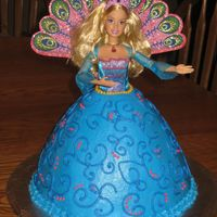 Barbie Island Princess Doll Cake This is my first doll cake! My daughter wanted a Barbie Island Princess themed cake for her 5th b-day. I used the Wilton Wonder Mold cake...