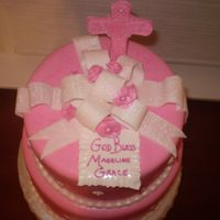 Madeline Grace's Christening 10 and 8 inch white cake filled with Cannoli cream and Chocolate Mouse. Cake was covered in Chocolate Ganache and then Fondant. Bow, Cross...