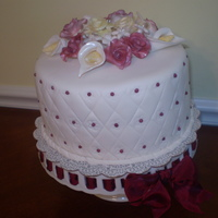 Maria's Bridal Shower Vanilla Chiffon Cake with Lemon Curd filling covered in fondant with gum paste flowers.