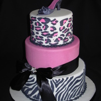 Animal Print Dummies for a display at an auction. Fondant with royal stenciling. Gumpaste shoe. Real ribbon - didn't want to make black fondant!