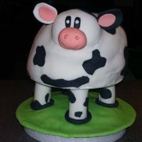 Moo Cow My first time at a cow cake, body and face is sculpted cake. Feet are cake columns wrapped in fondant.