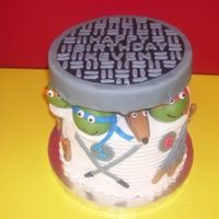 "Tmnt Cake I decorated this 8""round with fondant turtles, Splinter and weapons. I used styrofoam covered in fondant for the sewer lid."