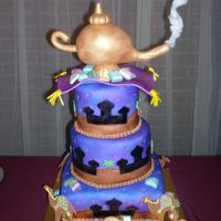 Arabian Nights My first airbrush cake. I also made my own stencils for it. Chocolate gems and fondant camels. Everything is edible except for the lamp.