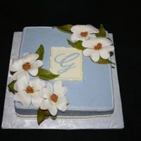 Dogwoods For an Easter birthday. Gumpaste dogwoods; fondant leaves, painted for color variation; White Chocolate monogram plaque. I didn't have...