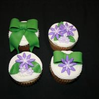 Purple And Green Cuppies For a baby shower. BC icing, fondant accents