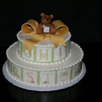 Abc Bear Buttercream with gumpaste bear and ribbon