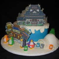 Club Penguin Buttercream. Gumpaste with edible image buildings, RKT and fondant figures. The village, the dojo and the fire dojo.