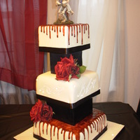 "Gothic Wedding Designed by the bride. She wanted dripping blood that was dark red, and a monogram with ""bling"". Fondant with piping gel ""..."