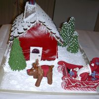 Christmas 2006   This cake-house I made for Christmas. The walls are med of marcipan and the roof of SP. All the other are made of SP.Thanks for looking!