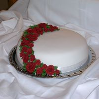 Wedding Cake  This is my first wedding cake! It´s made of vanilla cake, raspberry mousse and Japp mousse and covered with SP.The roses are made...