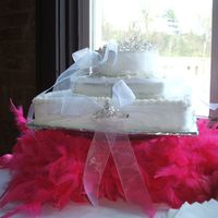 Tiara Cake This was a practice cake for a very small bridal show. These are actual tiaras placed on the cake and I put a hot pink boa under for...