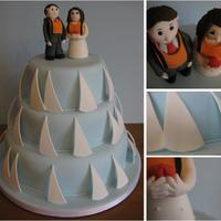 Sailing Wedding Cake This couple met whilst dinghy sailing and they wanted their wedding cake to reflect this so each tier was decorated with sails and the...