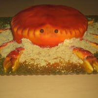 Have A Crabby Birthday 3D crab, covered in fondant and airbrushed. Claws are made from fondant also.