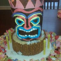 Tiki God made for my daughter's 12th birthday. Tiki is chocolate buttercream with fondant accents. Bottom tier is buttercream with pretzel...