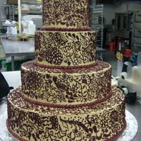 Henna Indian Wedding cake done for an Indian couple at work. They wanted the whole cake to show the traditional henna design worn on the bride's...