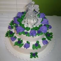 Simple Wedding Cake   mexican vanilla wedding cake with indydebi's frosting. violet rose buds.