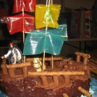 Pirate Ship Cake I stole this idea from cakecentral.com. It was harder than it looked. My husband helped me do it.