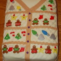 Christmas Sweater Cake  made for a christmas sweater part. vanilla cake covered in MMF, decorations are MMF except for sprinkles on the christmas trees and candy...
