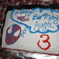 Spiderman Cake chocolate cake. white whipped frosting. buttercream decorations. i am terrible at writing with frosting. sheesh.
