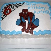 Spider Man   White Cake w/ Strawberry Cream Filling. Frosting is a Whipping Icing w/ Marshmelloe fluff. This lady loves..that icing!