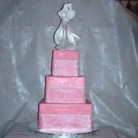 Classy-N-Pink. Cake is wrapped in a pretty pink fondant, then w/a pearlized white ribbon w/the same colored pink stenciling detail. The pearl sheen on the...