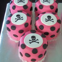"Mini Skull Cakes Mini cakes for birthday party. 3 1/2"" rounds. SI fondant. Made a stecil and painted the skulls on using food coloring. Thanks for..."