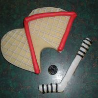 Hockey Net ,stick And Puck Cookies I got this idea from user: nickdrewnjaysmom. I drew freehand the designs and then made my own cookie cutters to cut them out with. I am soo...