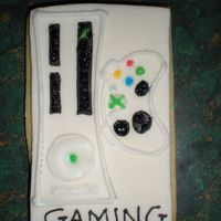Xbox Cookie I drew this pcicture freehand onto a piece of homemade MMF. Used Antonia74 icing to outline and fill in the picture. This was one of the...