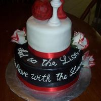 "Twilight Cake Cake based on the twilight books, the quote reads ""And so the Lion.. Fell in Love with the Lamb"" the chess pieces are gumpaste..."