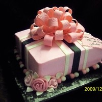 "Pink And Black With Big Bow 10"" Sq. white cake, pink icing, black and white strips, big bow on top"