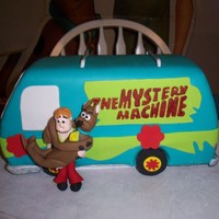 Scooby Doo Mystery Machine Cake Carved cake, chocolate cake w/ buttercream icing as filling. Scooby & Shaggy made of fondant (used guide in Debbie Brown's book -...