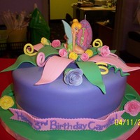 "Tinkerbell 10"" covered in fondant. Leaves & flowers made of fondant"