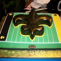 Saints Cake Sheet cake with an airbrushed fleur de lis on top.