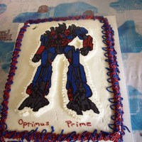 Optimus Prime Birthday Cake For My Son...   The candle had been removed when we took the picture...that's why there is a hole in the frosting at the top.