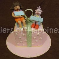 Dora And Boots fondant dora and boots on a fondant covered cake. vanilla cake with cookies and cream filling