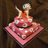Betty Boop Cake this was for a 21st birthday, the birthday girl loves betty boop and the party colours were pink black and white.the cake is a chocolate...