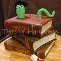 Book Worm Graduation stack of books cake,top and bottomcakechoc mud with middle cake oreo cake. all covered in fondant, book worm inspired by debbie brown'...