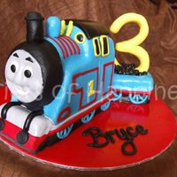 Thomas The Tank Engine choc mud carved to be thomas the tank engine.covered in fondant