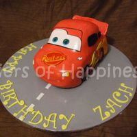 Lightning Mcqueen carved choc mud cake with choc ganache, covered in fondant, embelishments painted with food colour