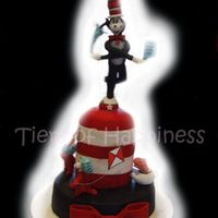 Cat In The Hat choc mud with cookies and cream filling.covered in fondant. modelling paste figures of cat in hat, thing 1 and thing 2 and fish in teapot