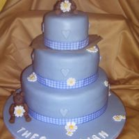 Blue Christening Cake  3 tier chocolate cake with chocolate buttercream filling covered in blue fondant. The bears, flowers and letters are made with modelling...
