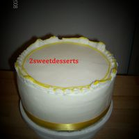 Yellowwhite.jpg   dummy with butter cream and ribbon accent