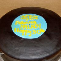 "Record Birthday This is a 10"" yellow cake, covered in black fondant made to resemble a vinyl record."