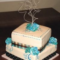 Blue And Brown Bridal Shower! This cake was done for a briadl shower who's colors were a bright blue and brown. The cake is a buttermilk white filled with...
