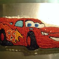 "Colbys_9Th_Birthday.jpg  I made this cake for our son's 9th birthday. He loves ""Cars"" and specifically asked for Lightning. I used the Wilton's..."