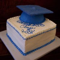 Graduation Cake  the cap is a piece of cardboard covered in tinted white chocolate candy melts )I didn't have any fondant on hand)' I also used a...