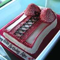 Corset Cake For 60Th Birthday This is a white cake with lemon filling. Decorated with buttercream. The black lace-up is fondant. We had a great time making this cake....