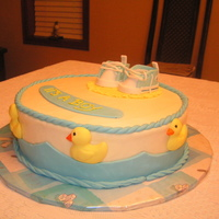 Baby Shower Cake White cake with lemon filling. Iced in buttercream. Accessories are made from fondant. TFL